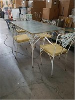 Ornate metal glass top patio table and 4 chairs