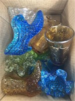 Box of glass colored shoes etc