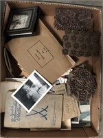 Box of old photographs and stamps