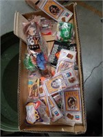 Box of collectible Laker pins toys and