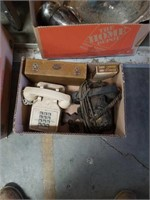 Box of old telephones