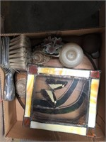 Box of butterfly, candle, shells etc