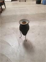 Ceramic vase with a metal rack