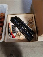 Box of rifle scopes and golf tees