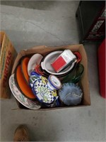 Box of cast iron pots with lids and Coca-Cola