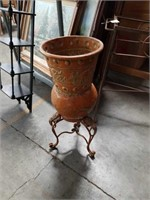 Footed metal flower pot