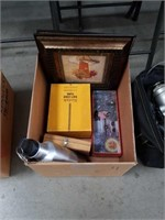 Box of pictures and wood tools