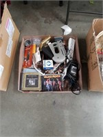 Box of C d's and household items