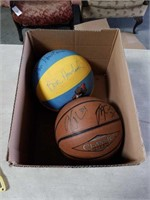 Box of basketballs with signatures