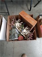 Box of artificial plants and ceramic rabbit