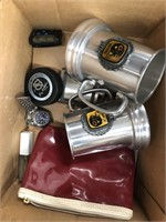 Box of miscellaneous items including sport mugs
