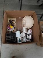 Box of iron coffee mugs and shoehorns