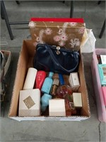 Box of vintage perfumes and handbag