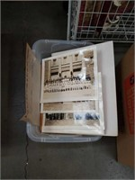Tub of old pictures and picture frames