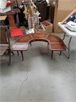 Horseshoe shaped leather top coffee table