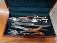 Case with several carving sets etc