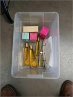 Tub of  Vintage perfumes and handbags
