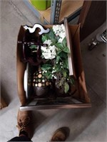 Box of artificial flowers and decorative pieces