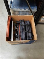 Box of bleacher cushions and trays