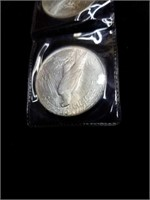2 piece silver dollars 1922 appraised BU