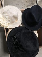 Box of vintage hats in cases