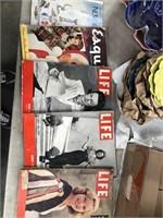 Box of vintage magazines including playboy