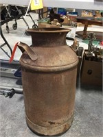 Milk can, has a rounded out bottom