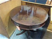 Round drum table with drawer & brass capped feet