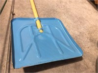 Small snow shovel & fishing poles with reels