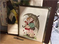Assorted sized wood framed decorator pictures