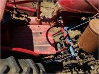 Vintage McCormick Farmall Cub Tractor with plow