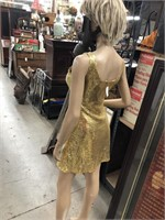 Mannequin with gold sequence dress,mask,wig