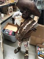 Metal folk art statue
