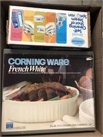 Box of Corning Ware and iron
