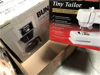Box with coffee brewer and singer tiny tailor
