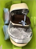Tub of dishes, electric grill, aluminum pot