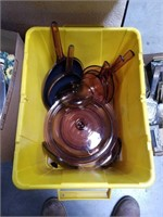 Tub of Corning glass pots and pans