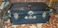 Black trunk with handles