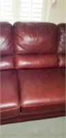 Nice leather couch with wooden legs