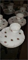 Set of 12 rose pattern cup and saucers,