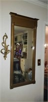 Beautiful gold like mirror with candle sconce