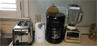 Toaster, rival can opener, coffee pot, blender