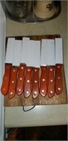 Cutting board with 8 steak knives