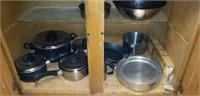 Entire contents of kitchen cabinet, pots