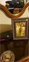 Framed painting of an angel and an alarm clock