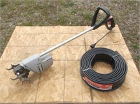 Electric Tiller and Roll of Lawn Edging