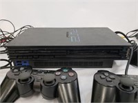 Two Playstation Two's With Controllers