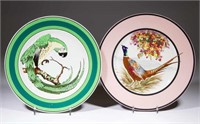Two plates designed by famous Buffalo Pottery employee Ralph Stuart, one signed and hand-painted by him. From the collection of the late Phillip M. Sullivan.