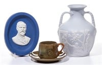 """Buffalo Pottery, including an important parian plaque in deep blue with white clay portrait of John D. Larkin, the founder of the Larkin Soap Company and Buffalo Pottery, commemorating the 50th anniversary of the founding of Larkin Soap in 1875; a reproduction of Wedgwood's Portland Vase, made in limited numbers and labeled as #16, made in the patented """"Lamelle"""" style; and Abino Ware, produced by Buffalo Pottery between 1911-1913. From the collection of the late Phillip M. Sullivan."""