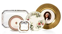 """Railroad ware made by Buffalo China, including an embossed gilt-rim plate having a hand-painted design of George Washington in the center made for the Chesapeake and Ohio railroad when they began operation of their 1932 """"George Washington"""" train in association with the bicentennial of George Washington's birth. From the collection of the late Phillip M. Sullivan."""
